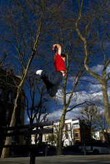 man jumping over bench