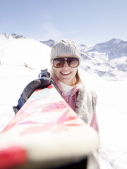 woman with skis facing camera