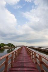Evening at red wooden bridge near Matchanu Shrine,Samut Sakhon,Thailand.