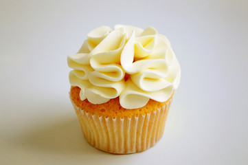 Cupcake with cream on white background. Picture for a menu or a confectionery catalog.