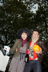 Man and woman going to Halloween party