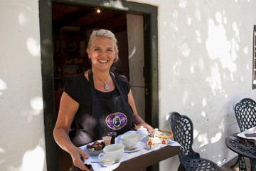 Woman serving tea and chocolate