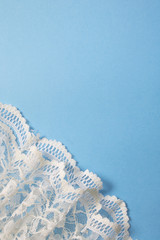 White Vintage Lace on Blue Background