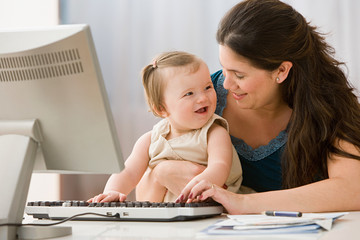 Mother and daughter using computer