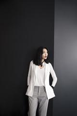 Portrait of beautiful Asian woman model posing in elegant clothes.