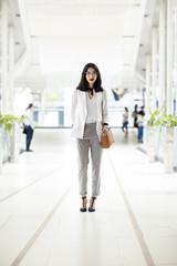 Portrait of beautiful elegant smart Asian businesswoman standing at shopping mall.