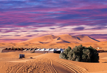 Foto auf AluDibond Wuste Sandig Camp site with tents over sand dunes in Merzouga, Sahara desert, Morocco, Africa