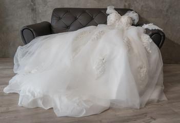 beautiful wedding dresses on sofa