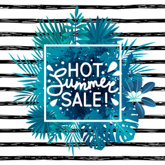 Summer sale message on tropical leaves background