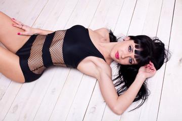 beautiful girl in black underwear lying on the floor