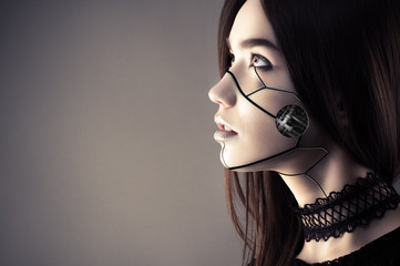 beautiful cyberpunk girl with fashion makeup looking up