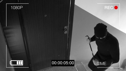 See CCTV as a burglar breaking in through the door with a crowbar.