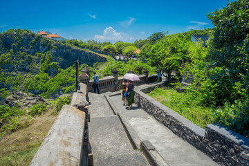 Beautiful sunny day for tourists to visit the amazing Uluwatu temple in Bali, Indonesia