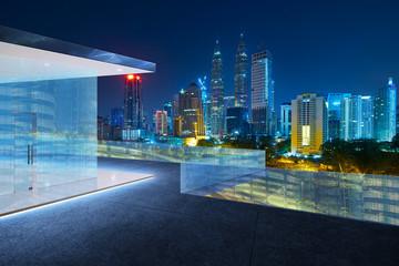Fotomurales - Kuala Lumpur skyline at night with balcony view .