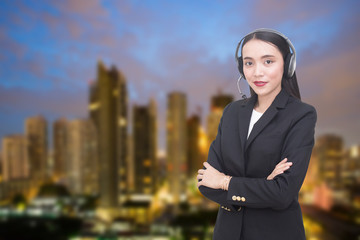 Support phone operator in headset at city background, woman with call center concept, 20-30 years old.
