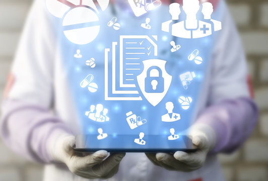 File Medical Data Security Safety Concept. Doctor holds tablet computer with file shield lock icon on virtual screen. Health care secure computing electronic information technology.