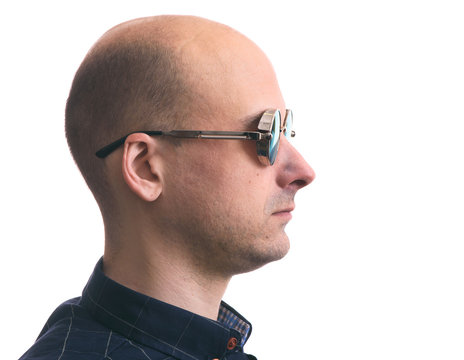 profile portrait of a bald man wearing sunglasses