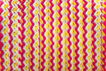 Texture braided rope white, yellow, and red colors. Background.
