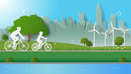 Green renewable energy environmentally friendly concepts, father and son are riding bicycle in city parks. Paper art vector illustration