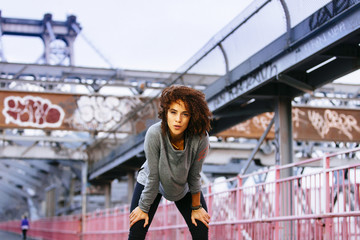 A woman during a workout on the Williamsburg Bridge in New York City.