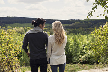 Young couple looking out at landscape