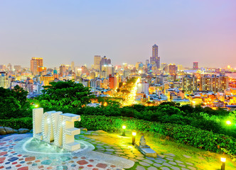 View of the skyline with the artwork in a park at night in Kaohsiung, Taiwan.
