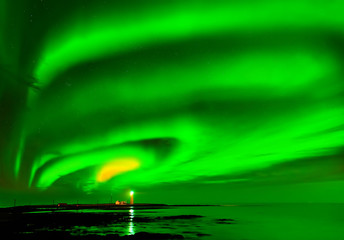 View of the northern light at Grotta Lighthouse in Reykjavik, Iceland.