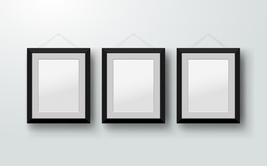Blank photo frames on the wall. Design for a modern interior. Vertical A-4. Vector illustration. Isolated on gray background