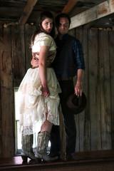 Cowboy holding woman