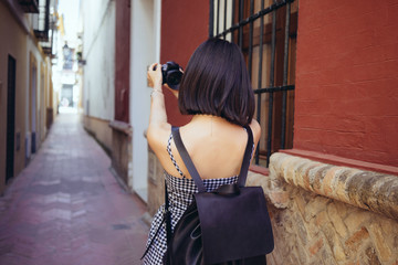 Woman taking selfie with photo camera