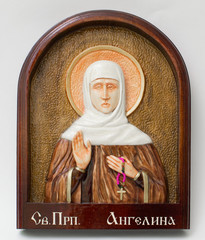 Carved icon from wood handmade. Holy angelina