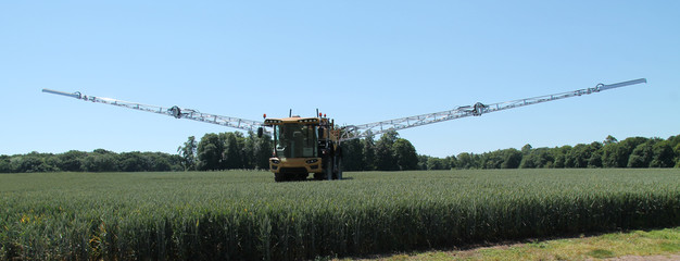 A Large Agricultural Farm Crop Spraying Vehicle.