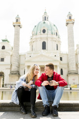 Couple happy in love taking selfie self-portrait photo in Vienna, Austria