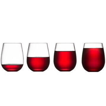 Stemless wine glasses filled with red wine isolated on a white background