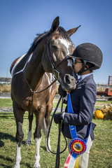 Young Girl Kisses Her Horse