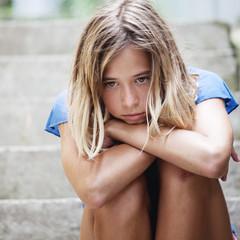 Sad teen girl outdoors