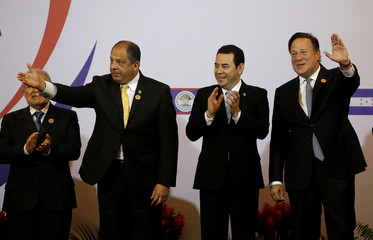 Presidents attend a group picture session during a meeting of the Central American Integration System (SICA), in San Jose