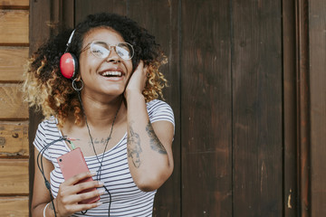 young woman happy listening to music with your phone