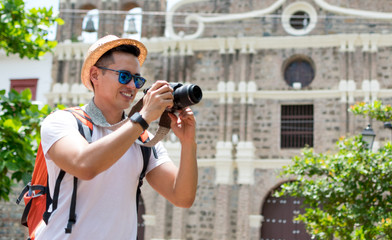 Portrait of happy tourist taking pictures