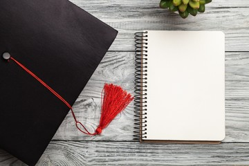 Graduation hat and notebook.