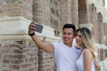 Couple in love taking a selfie with a smartphone