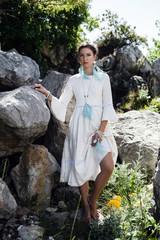 bohemian female standing in stones