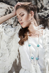 beautiful portrait of gorgeous boho girl in white clothes