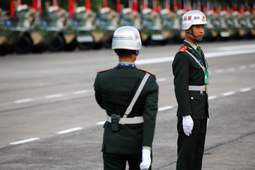 Soldiers stand at attention at a People's Liberation Army (PLA) base in Hong Kong as part of events marking handover anniversary