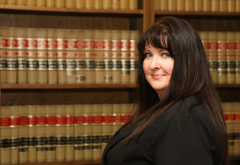 Portrait of a woman, female lawyer in law office