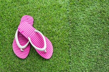 Pink sandals on grass
