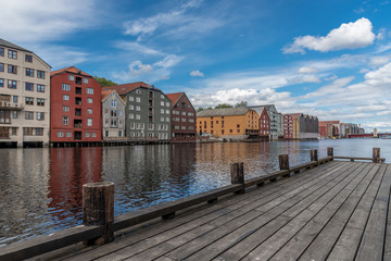 Traditional fisherman wharf with old storehouses along the river Nidelven. Trondheim, Norway.