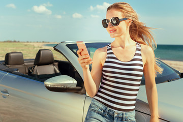 Young woman in sunglasses making self portrait