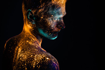 Portrait of a man painted in fluorescent UV colors.