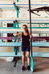 young woman athlete holding paddle